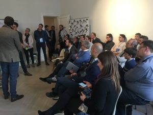 group-sitting-listening-presentation